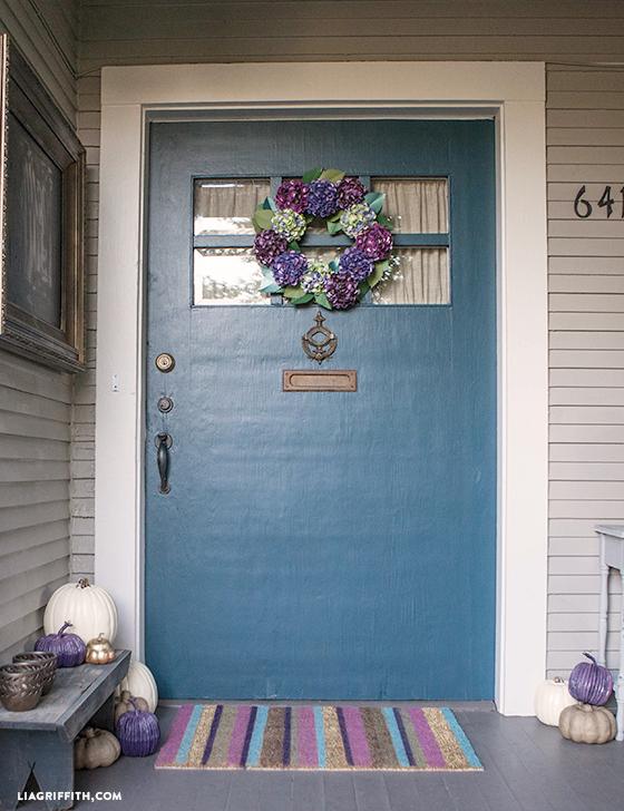 diy paper hydrangea wreath on front door with DIY pumpkins