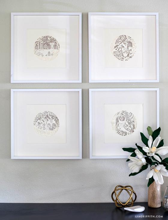 Four Seasons Artwork on wall next to crepe paper magnolias