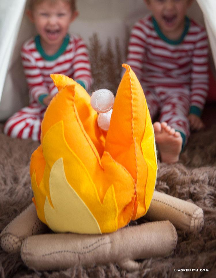 toasting marshmallows around a felt campfire