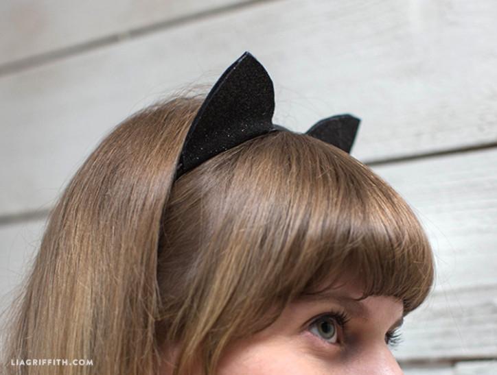 Woman wearing felt cat ears for Halloween