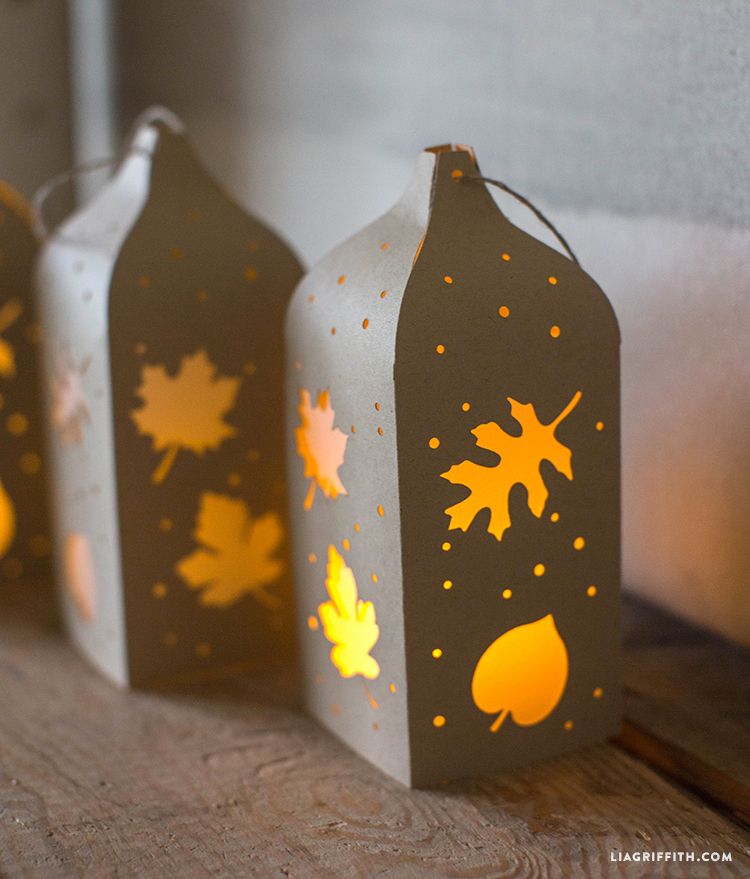 fall paper cut lantern with leaf and acorn patterns