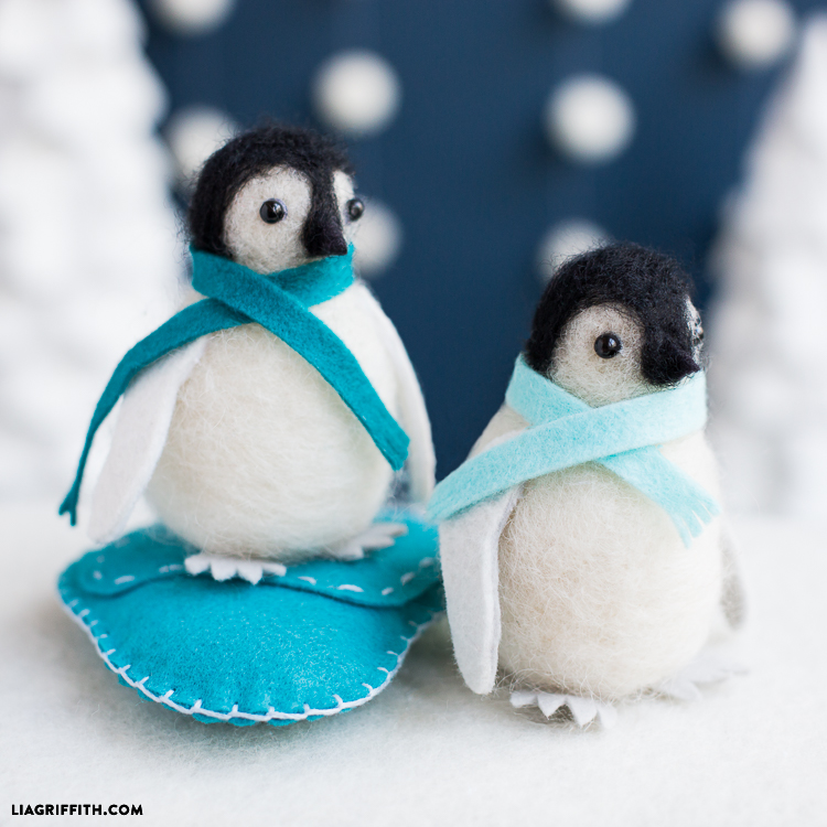 needle-felted penguin on felt iceberg and needle-felted penguin on faux snow