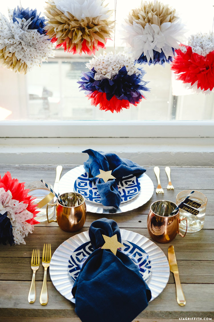 4th of July tissue pom poms with table settings