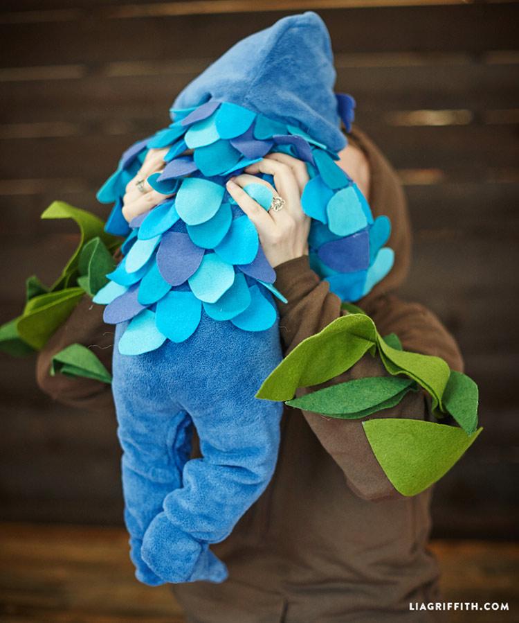 Mom holding baby in DIY owl Baby Halloween Costume