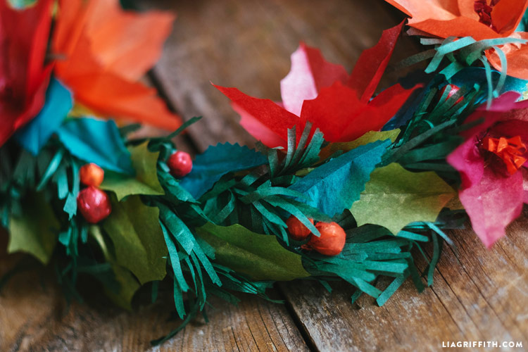 tissue paper holiday wreath with poinsettias and berries