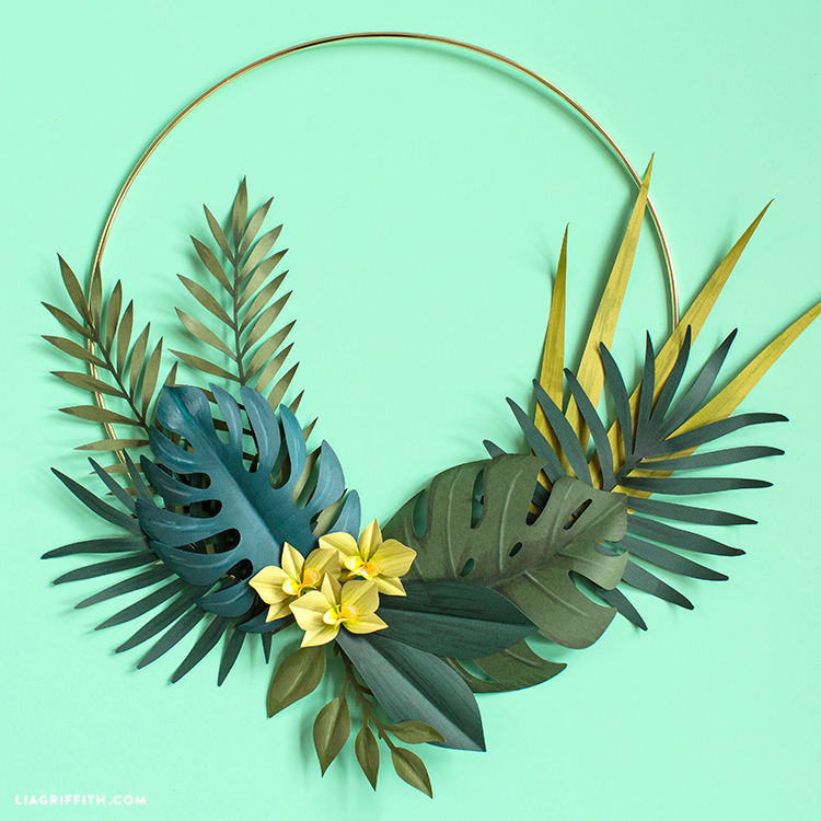 Diy Tropical Wreath Tropical leaves are the perfect way to transform your home into an island oasis and there are plenty of ways to do it! diy tropical wreath