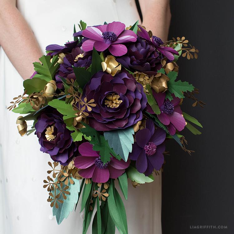 arranging a paper flower bouquet
