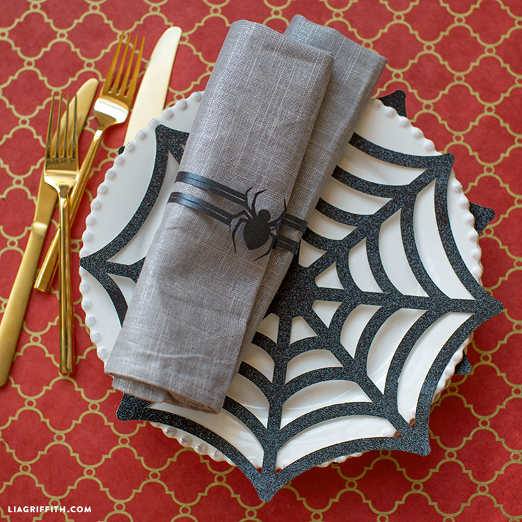 DIY paper spiderweb placemats and spider napkin rings