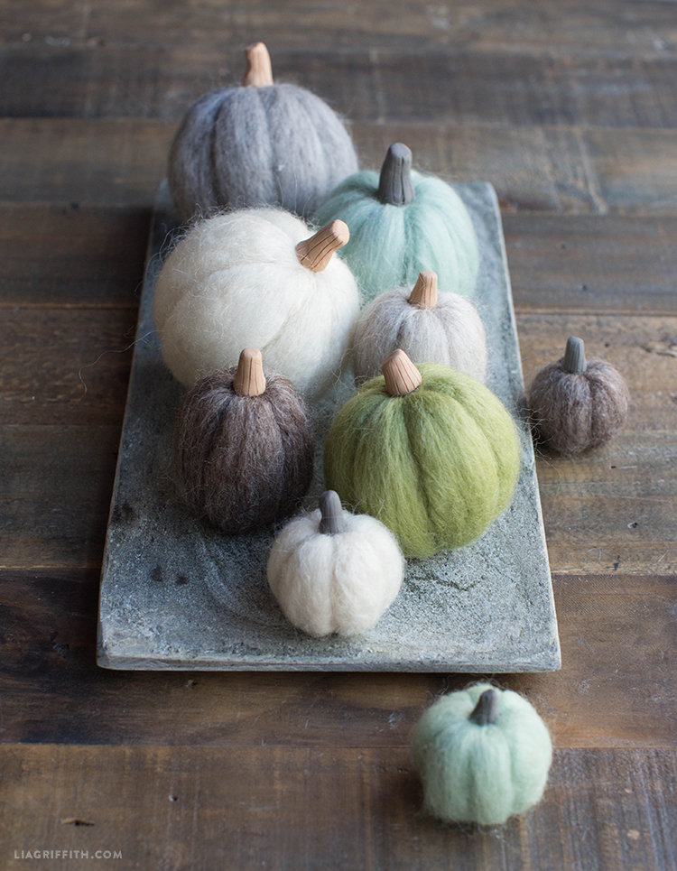 diy needle felted mini pumpkins on tray and table