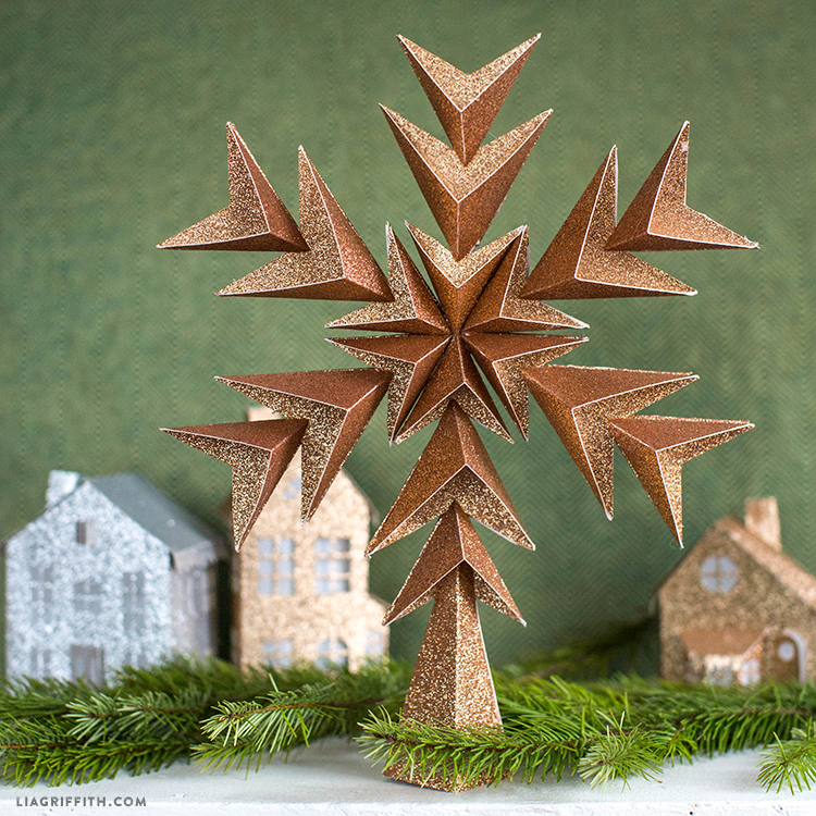 glitter paper star tree topper with glitter 3D houses and garland