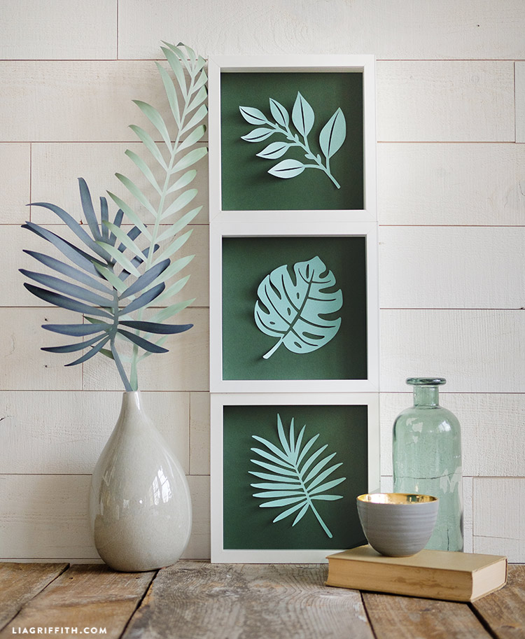 framed papercut tropical leaves