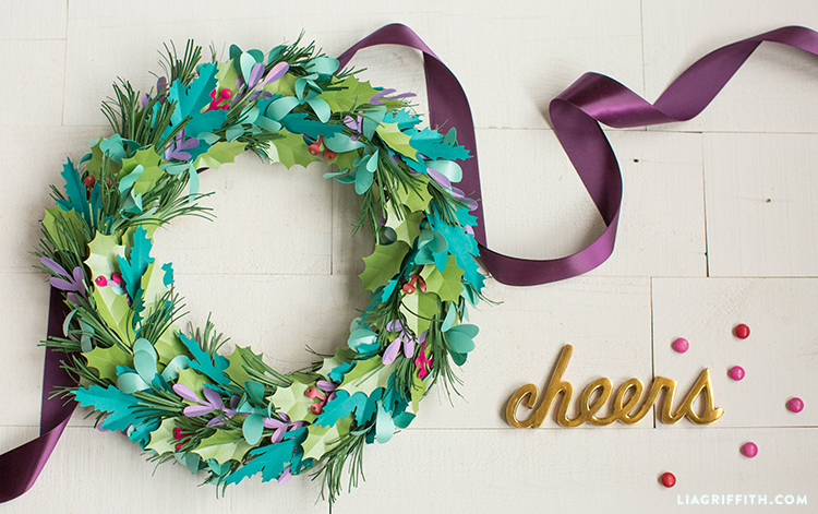"DIY paper holiday wreath with purple ribbon and gold ""cheers"""