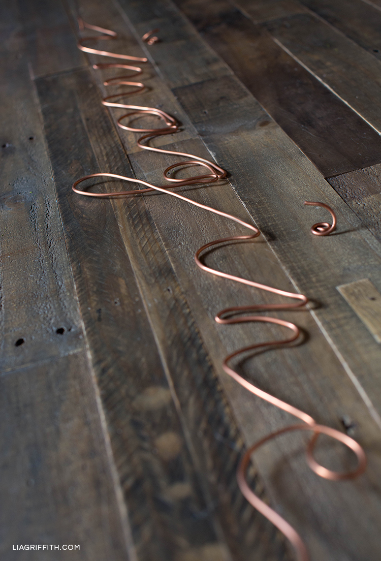"""Close-up of copper wire word """"imagine"""""""