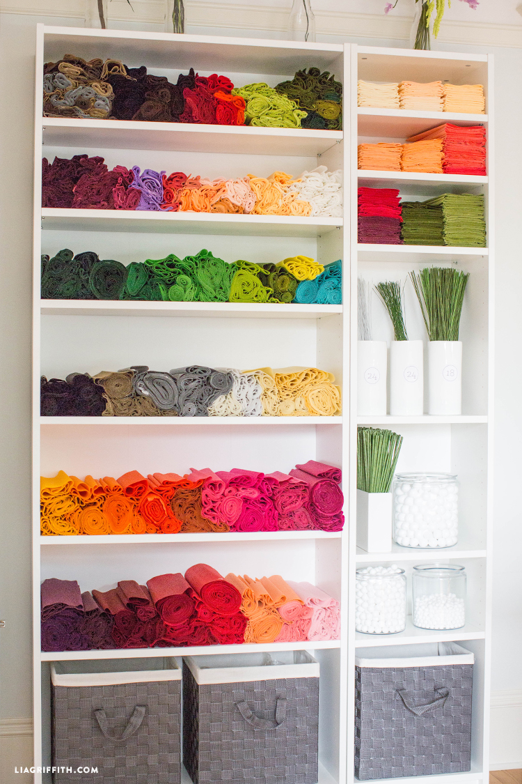 Craft room shelving unit with organized craft materials