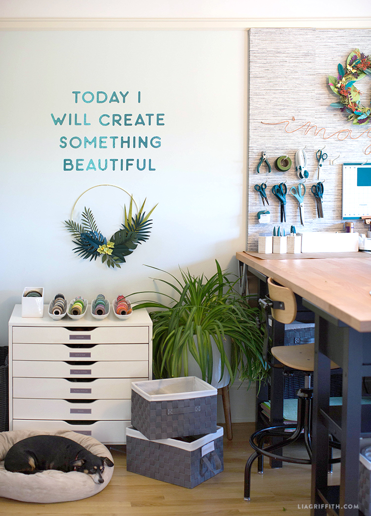 """""""Today I will create something beautiful"""" vinyl decal on craft room wall with dog"""