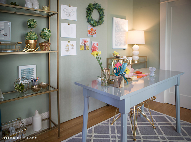 Creative workspace with grey desk and gold etagere from Hayneedle