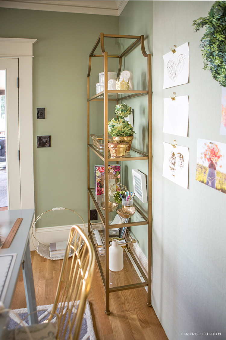 Creative home office with gold etagere from Hayneedle