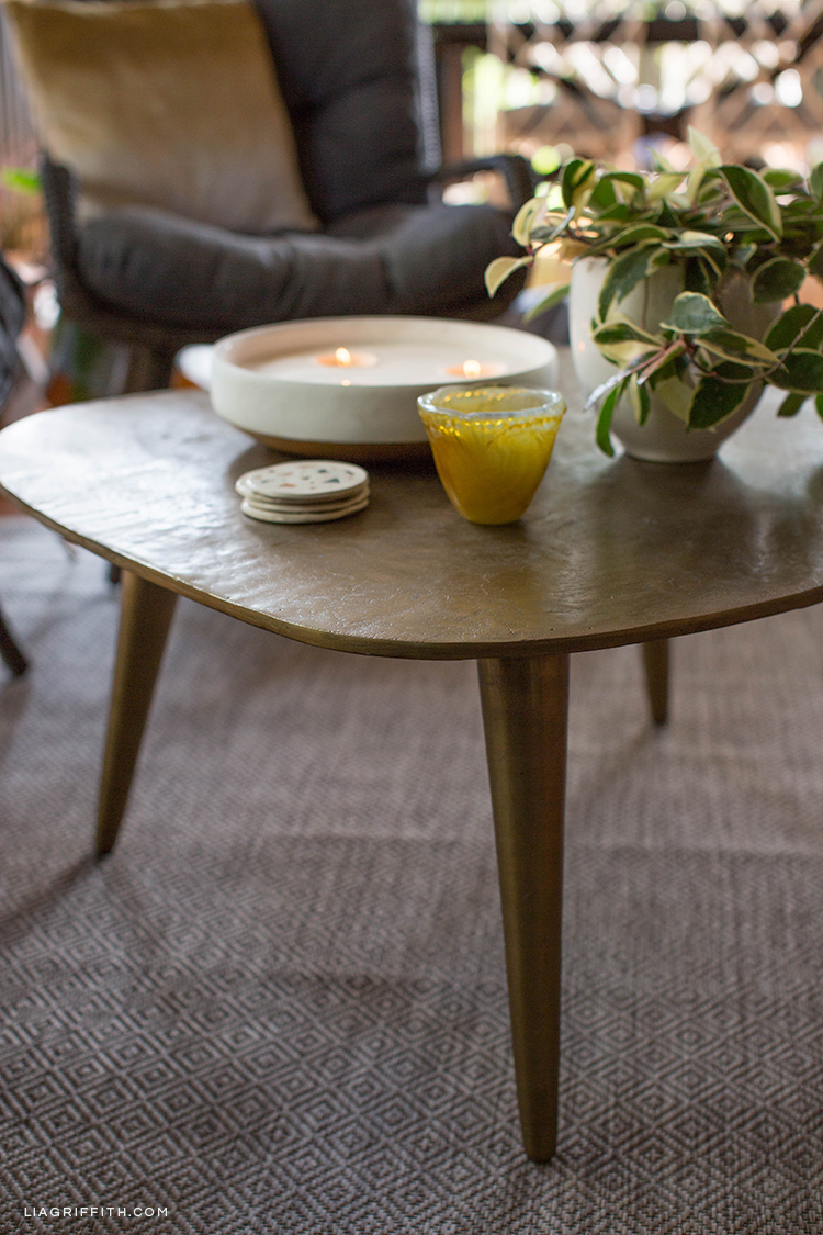 Imax Gokey Cocktail Table with plant and DIY terrazzo coasters