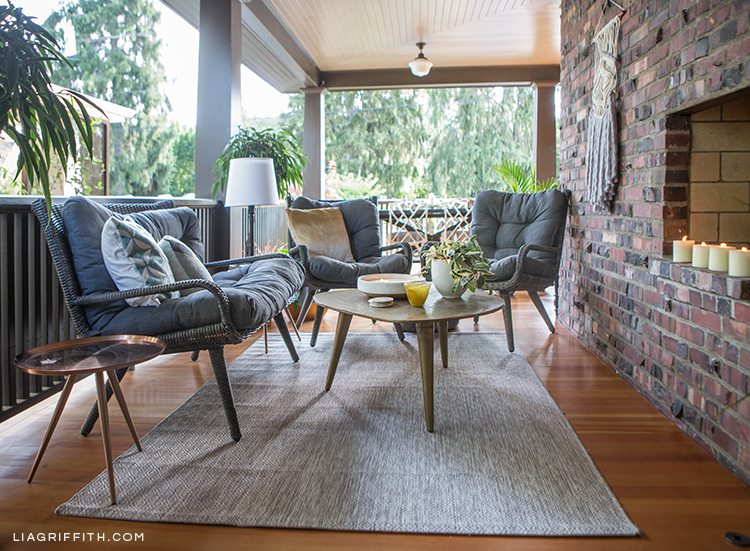Hayneedle wicker conversation set, cocktail table, copper side table, and indoor/outdoor rug on porch