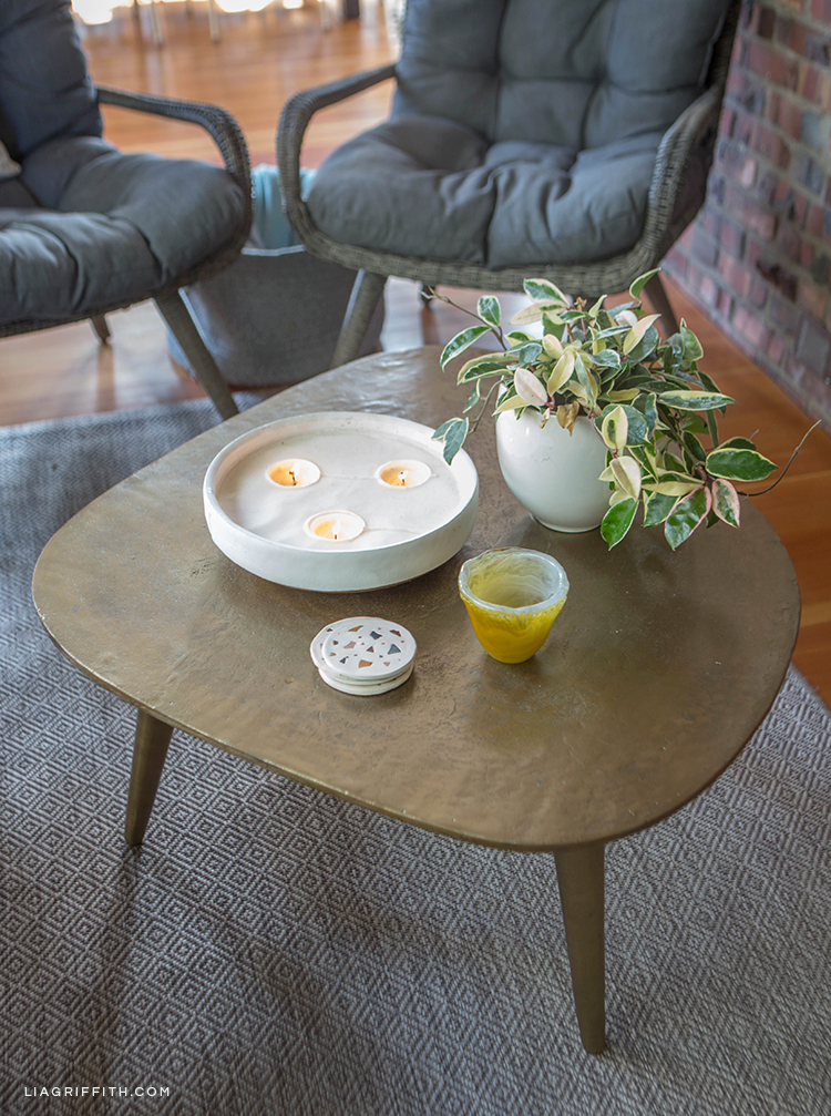 Hayneedle cocktail table with tray, plant, and DIY coasters