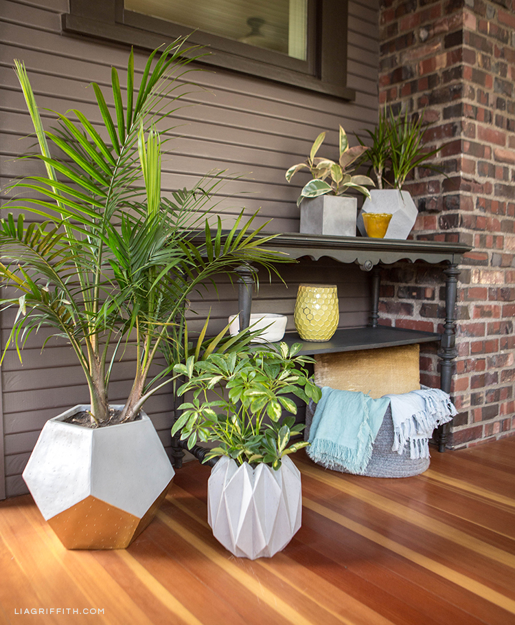 Hayneedle geometric planters and storage basket with DIY linen throws under table on front porch