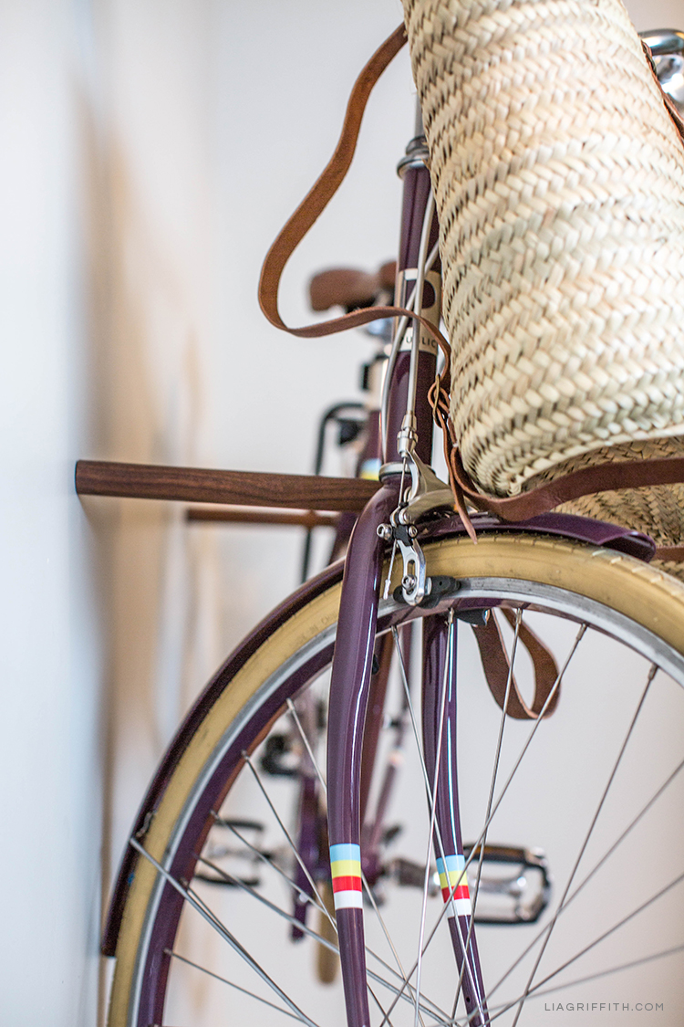 Close-up of purple bike and bag on bike sticks from Loma Living