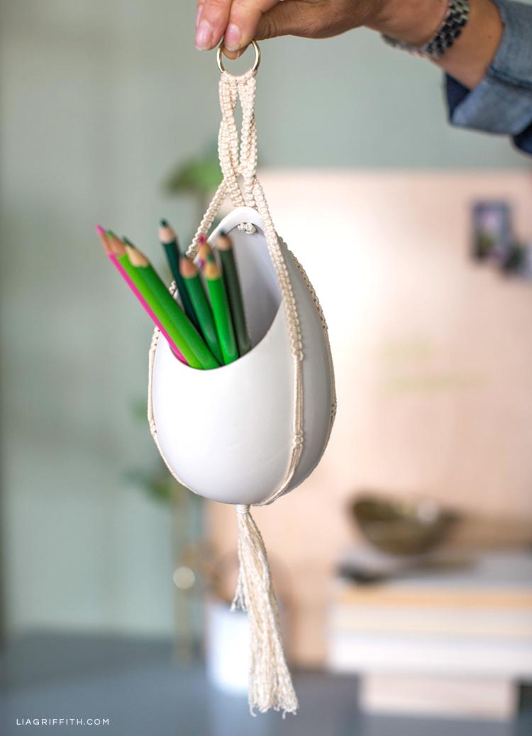 Close-up of DIY macrame pencil holder