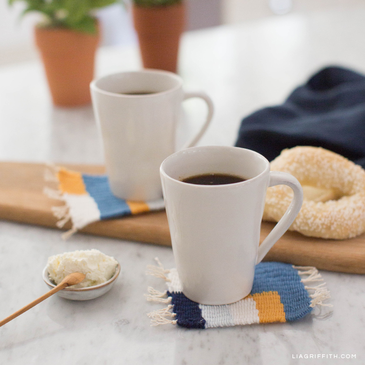 Coffee mugs on woven coasters on kitchen table