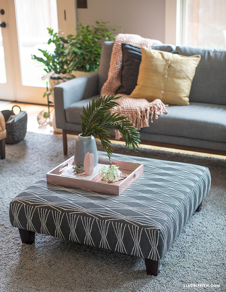 Updated ottoman in living room next to couch