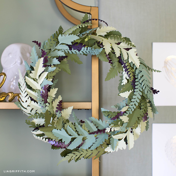 Paper fern wreath on gold shelving unit