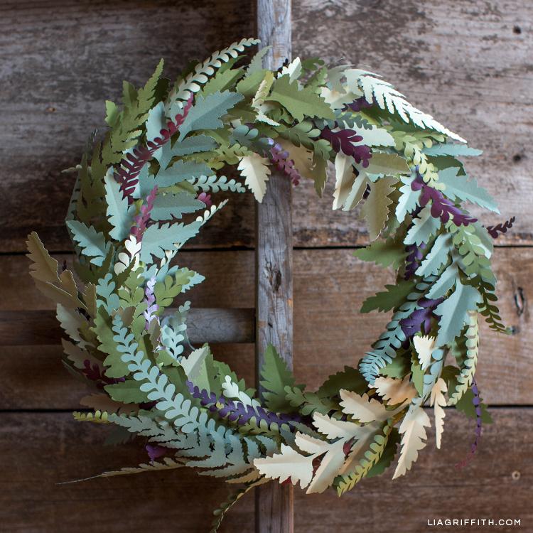 Paper fern wreath on wood ladder
