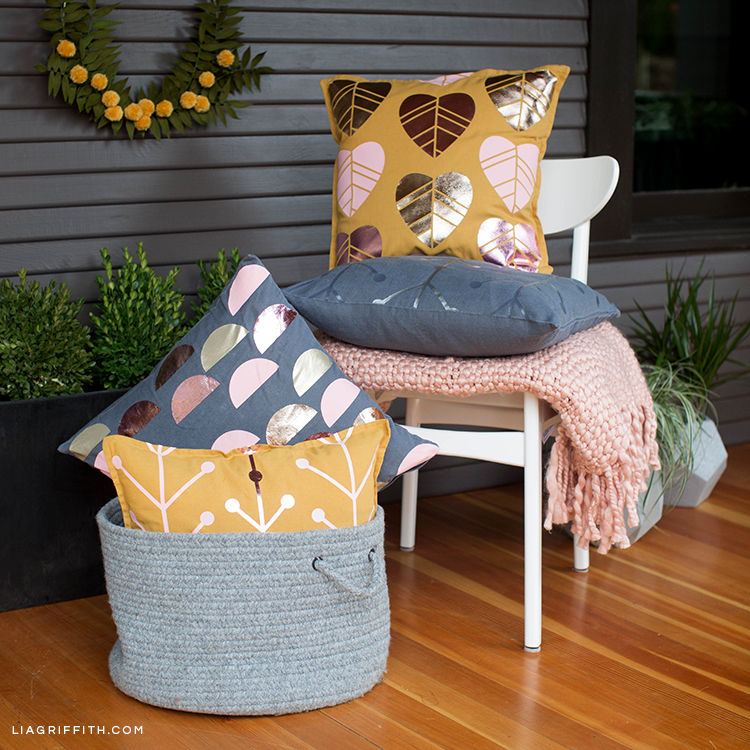 Scandinavian design outdoor pillows on chair and in basket
