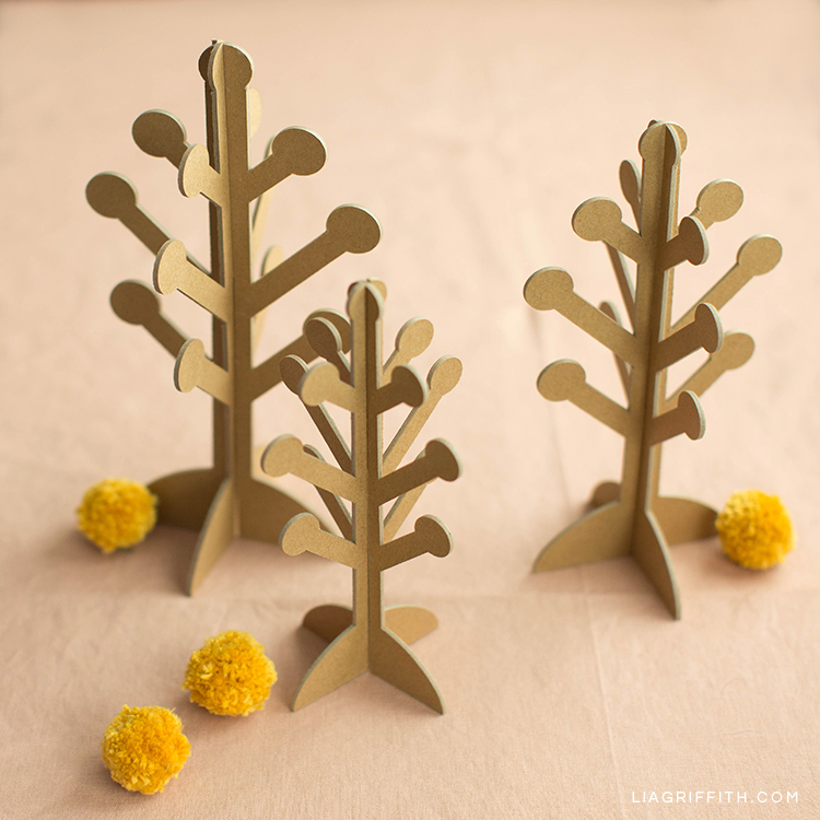 Scandinavian-style 3D paper trees with pom pom billy balls
