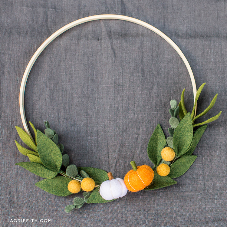 Mini pumpkin and greenery wreath for fall