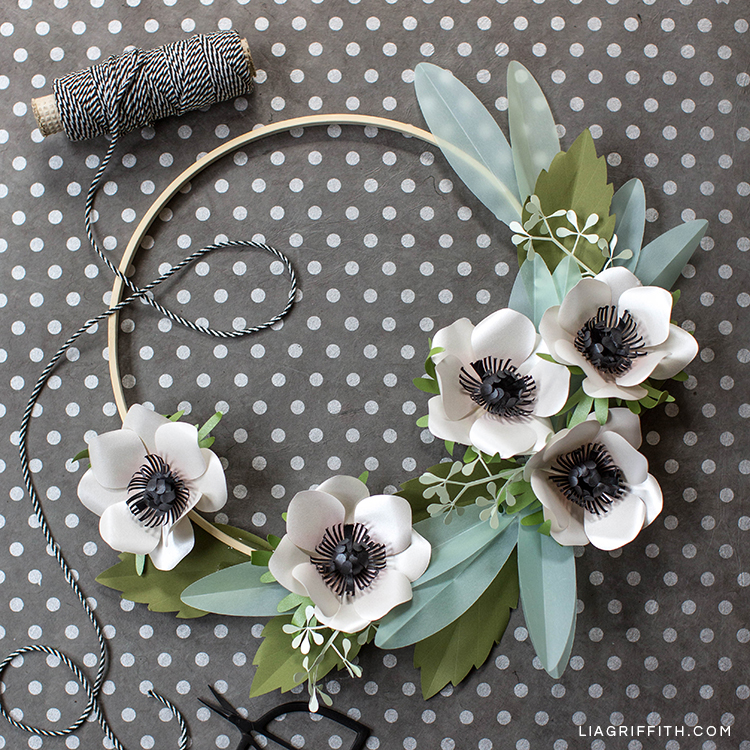 anemone and eucalyptus wreath next to string