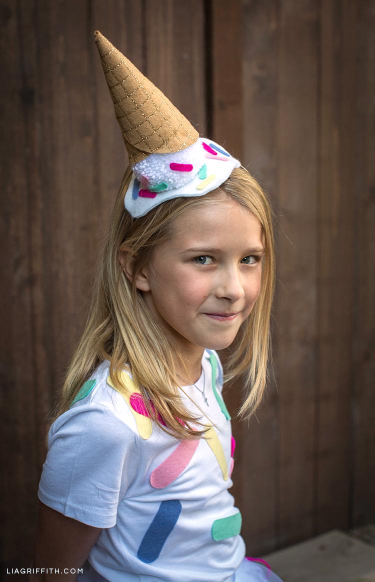 Girl wearing DIY ice cream cone costume