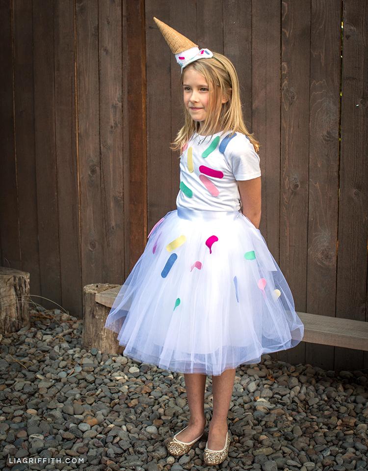 Girl wearing DIY ice cream cone costume outside