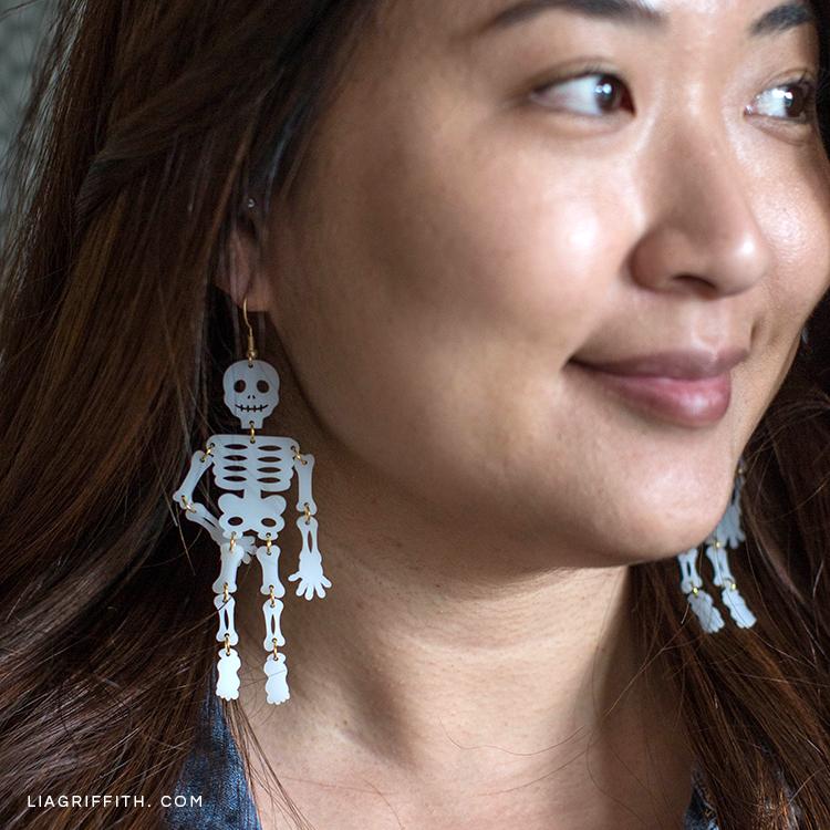 Woman wearing skeleton earrings for Halloween