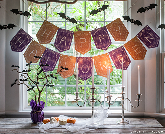 Printable Happy Halloween Banner with DIY bats above table