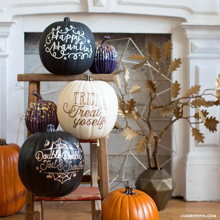 Halloween vinyl decals on pumpkins in front of fireplace