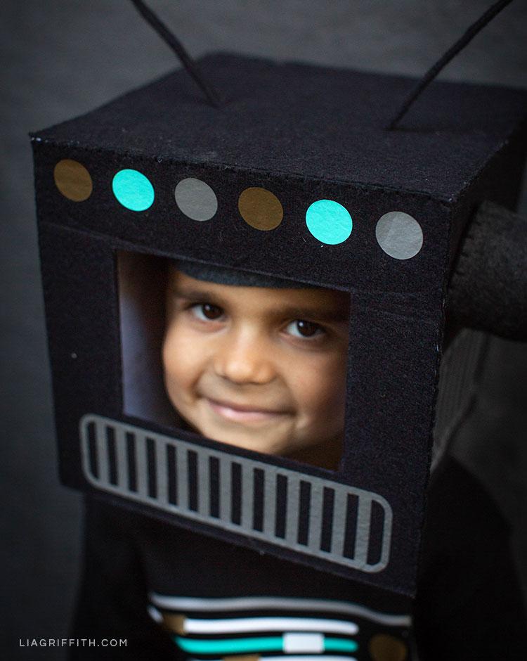 Boy wearing DIY robot costume for Halloween