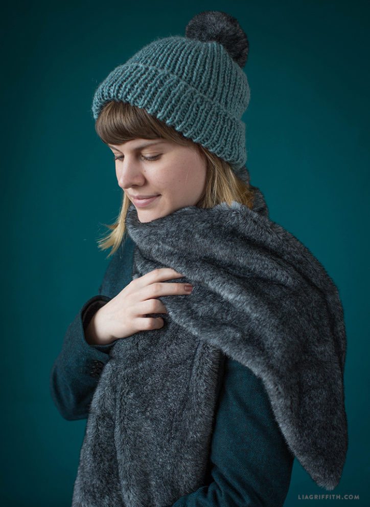 Woman wearing DIY knit beanie and faux fur scarf