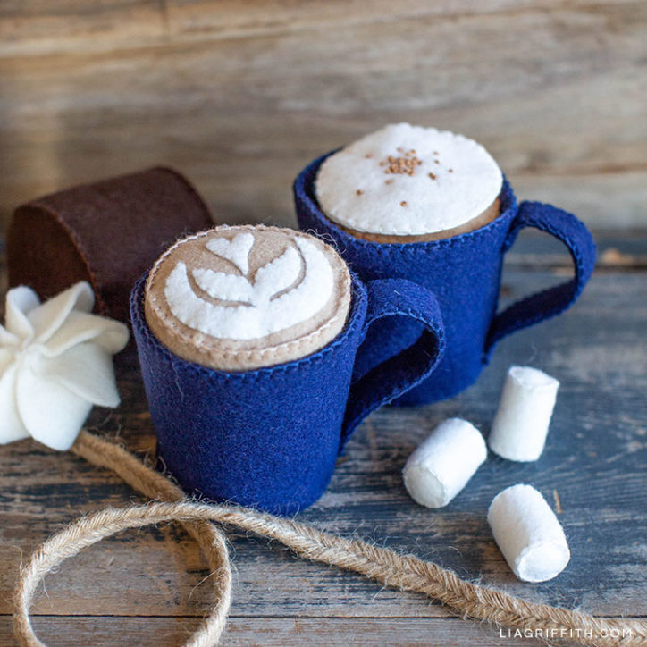 felt play cafe with hot cocoa, mini marshmallows, latte with foam art, and coffee with cream