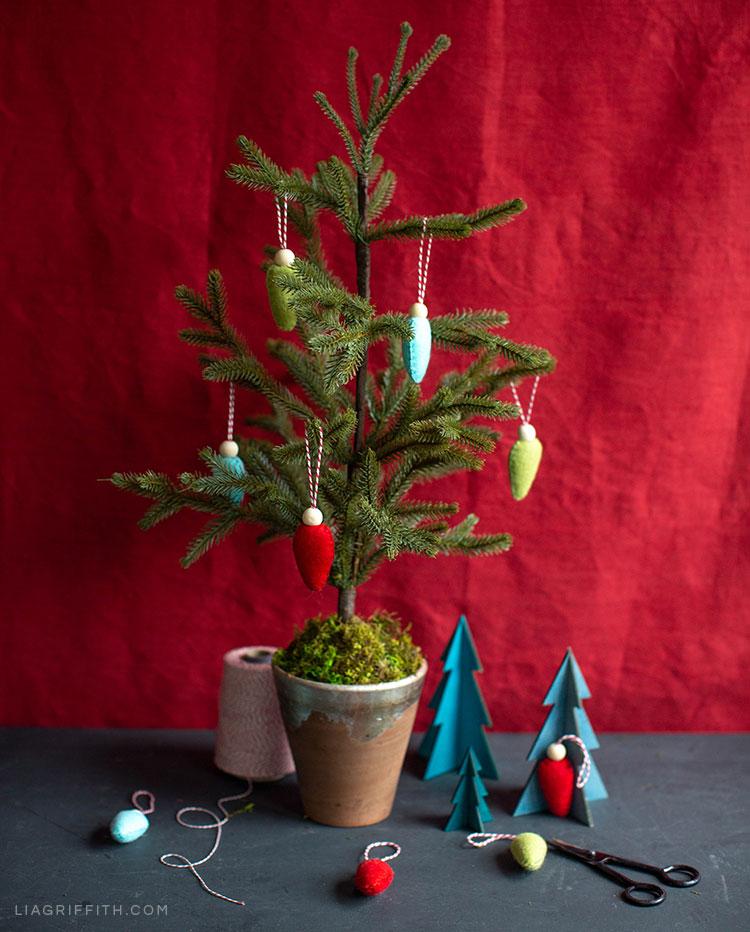Felt bulb ornaments on small Christmas tree in pot
