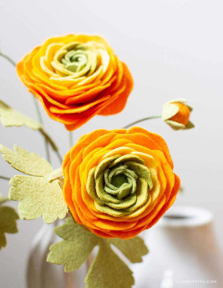 Orange, yellow and green felt ranunculus flowers