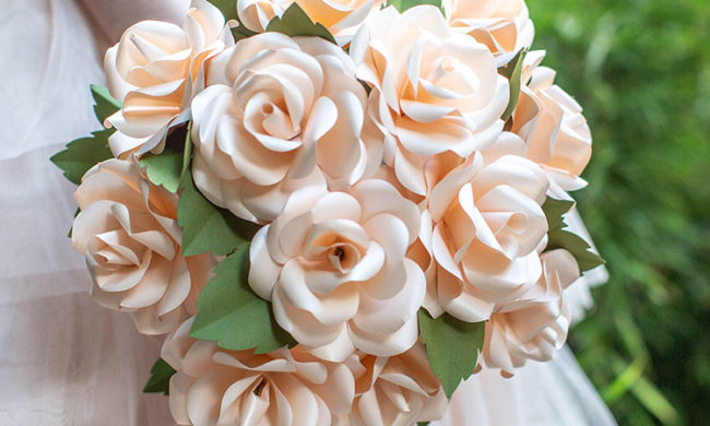 woman holding frosted paper rose bridal bouquet