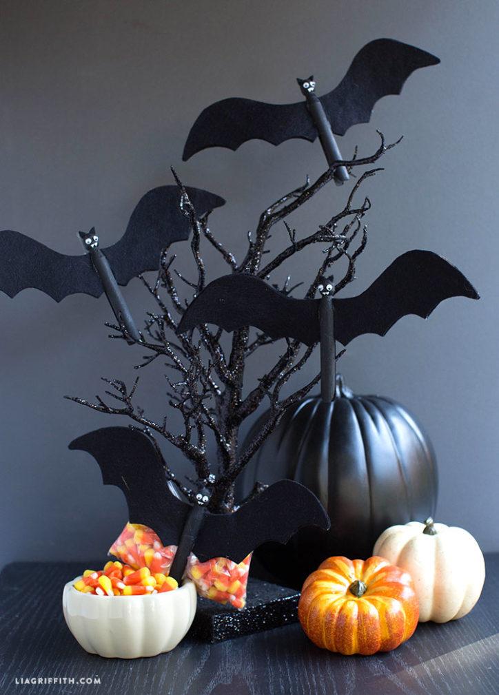 Clothespin Halloween bats next to pumpkins