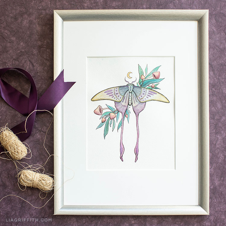Halloween coloring page with moth framed on wall