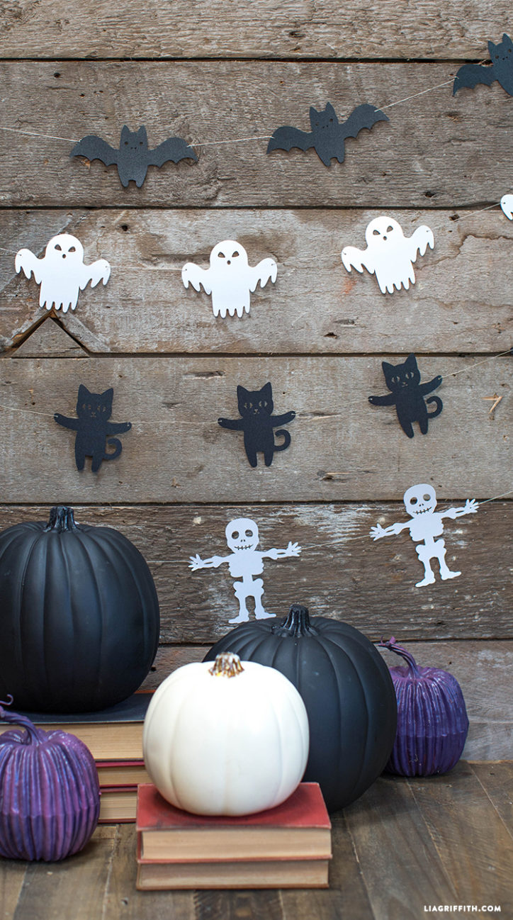 Halloween garland of papercut bats, ghosts, cats, and skeletons