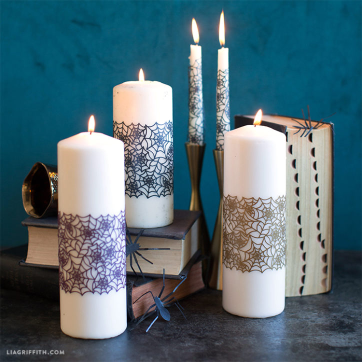 Papercut spiderweb candle wrap on candles